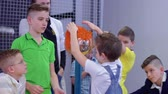 static electricity : Group of caucasian boys explores van de graaff generator in scientific musem Stock Footage