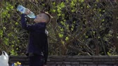 thirst quenching : Teenager drinks water in park