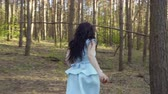 turns : Beautiful woman in blue dress running in the forest, Snow White fairytale Stock Footage