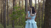 раздражение : Beautiful woman in blue dress wave off from insects in the forest Стоковые видеозаписи