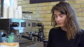 coffee machine : Smiling barista at work place in cafe Stock Footage