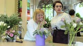 floristic : Two florists make flower composition in flower shop Stock Footage