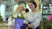 floristic : Florist and her assistant demonstarate complete flower composition