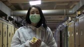 nestling : Inspector with duckling in hands walk through corridor near incubators at farm Stock Footage
