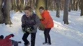 bola de neve : Children play in winter park, slow motion Stock Footage