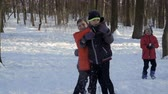 śnieżka : Four little brothers play snowballs in winter park in slow motion