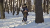 wintertime : Adorable children in winter park Stock Footage