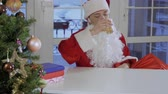 koku : Drunk Santa drink whisky sitting at the table Stok Video