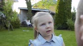 предотвращать : Cute little girl make training exercises for her eyes