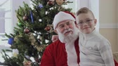 toy : Little boy hugging with Santa Claus