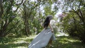 ucieczka : Gorgeous woman run through a garden in slow motion