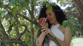 poisoned : Charming woman with red apple enjoy a smell of fruit and smiles to camera