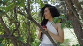 poisoned : Elegant woman with red apple in the garden Stock Footage