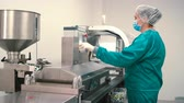 pharmaceutical factory : Worker adjust the pharmaceutical machine for making capsules