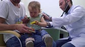 pediatrician : Pediatrician check the heartbeating of little girl with stethoscope