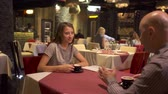 сказать : Lovely adult couple have a date at restaurant and drink coffee