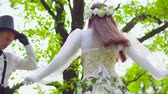 korzet : Beautiful actors dance on stilts at the park