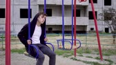 huysuz : Young man in a poor state of health sits on a swing