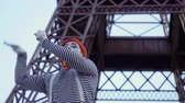 gesticulando : Funny man mime pulling something at Eiffel tower background
