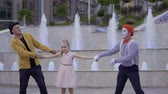 humorous : Funny mime and magician pulling girl to himself by the hands