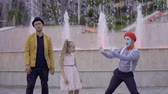 magic fountain : Magician and mime show their skills to little girl Stock Footage