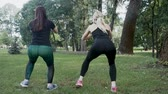 bounces : Two young girls doing exercises in the park
