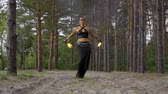 juggler : Beautiful woman does fire show in the forest Stock Footage