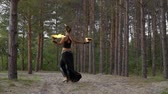 ručně malovaná : Woman in the forest is dancing with fire bowls