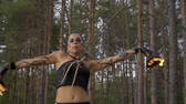 juggler : Woman in the forest is dancing with fire bowls