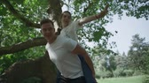piggyback : Young couple is spinning around in the park