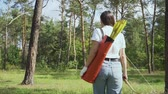 bowman : Girl archer going through the forest Stock Footage