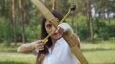 bowman : Girl archer moving bow between targets and shoots