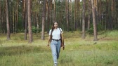 bowman : Female archer walking in the forest Stock Footage