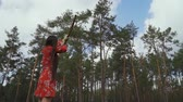 bowman : Girl in a red dress launched an arrow into the sky