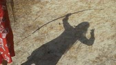 bowman : Shadow of female archer on the ground