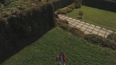 benzer : Mom and daughter wave hands on camera. Shot on drone