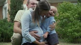 caressing : Father and little son hugging pregnant mom