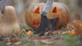 rite : Halloween. Scary pumpkin and butcher knife. Halloween concept Stock Footage