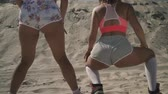cool figure : Two hot young girls with nice bodies dancing twerk in short shorts at the beach Ladies move their butts dressed in light shorts Females spending time outdoors