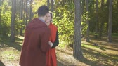sweetheart : Young interracial couple in love on a date outdoors. Asian guy kisses his caucasian girlfriend. Beautiful joyful couple in casual wear is relaxing in nature and spending time together. Stock Footage