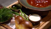 root vegetable dish : Borsch served in restaurant. Traditional ukrainian lunch close up Stock Footage