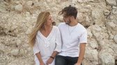 topic : Young beautiful couple stand near big rocks and talking Stock Footage