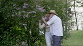 família : Beautiful senior couple enjoy summer nature Stock Footage