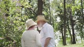família : Man and woman in love walking in summer park