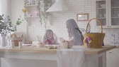 forties : Cute mother and her pre teen daughter arguing on the kitchen. Woman explaining to the girl the reasons, but stubborn daughter defends her opinion. Relationship mothers and daughters. A happy family. Stock Footage