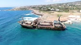 kıbrıs : Video from above. Aerial view of sea coast. Flying over coastline with broken ship. Mediterranean Sea and the coast. Shooting from the drone. Cyprus. Stok Video