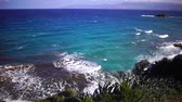 путешествие : Beautiful view of the coast. The waves roll on shore. Cyprus. Slow motion. Стоковые видеозаписи