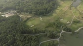 kurzus : Aerial view of large luxury golf course. View of the green lawns and trees. Shooting from above, top view, drone shooting.