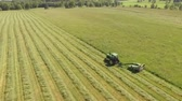 wheeled : Tractor Cutting Grass On A Large Field Stock Footage