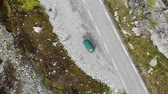 небольшой : Vehicle Parked On Side Of Road On Mountain. Oslo. Norway